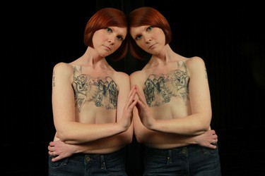 Kelly Davidson poses for a photo in Ottawa Ont. Friday, April 12, 2013. A three-time cancer survivor from Ottawa is behind one of the Internet�s latest viral photos. After a double mastectomy, Kelly Davidson opted for a tattoo where her breasts used to be, rather than having reconstructive surgery and her photo of the tattoo has caused an explosion of reaction on Facebook.  Tony Caldwell/Ottawa Sun/QMI