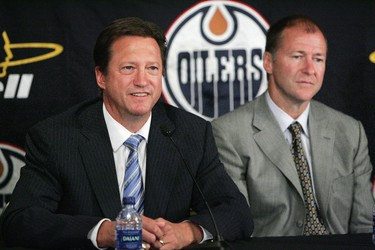 Steve Tambellini (left) is unveiled as the Edmonton Oilers' new General Manager, and outgoing GM Kevin Lowe, right, is unveiled as the Edmonton Oilers' new President of Hockey Operations during a news conference in Edmonton, Thursday, July 31, 2008.  THE CANADIAN PRESS/Edmonton Sun-David Bloom
