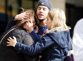 People comfort each other after explosions went off at the 117th Boston Marathon in Boston, Massachusetts Monday.  REUTERS/Jessica Rinaldi