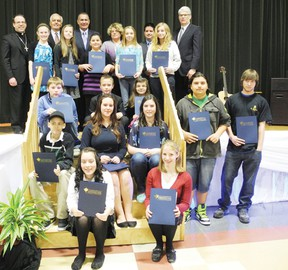 Parents, school trustees and other officials of the Catholic District School Board of Eastern Ontario were at Holy Trinity Catholic Secondary School on Monday morning to congratulate the 16 Bravo Breakfast Award recipients who won awards for their contribution to their school and community with positive attitudes and good values. Staff photo/ERIKA GLASBERG