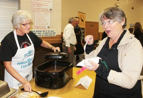 Lin Steffler, of Seaforth, enjoys a sample of soup served up by Sheila Lavoie at the Souper Saturday event to raise money for the Seaforth and District Food Bank.