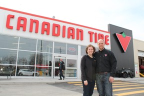 Associate dealer Karel and his wife Krista van Tol pose in front of the new Canadian Tire store in Paris, Ontarion on its opening day, Thursday, April 18, 2013. MICHAEL PEELING/The Paris Star/QMI Agency