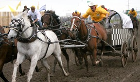 HIGH RIVER TIMES FILE PHOTO. Jason Glass during night three of the 2012 North American Chuckwagon Championship as part of the annual Guy Weadick Days.