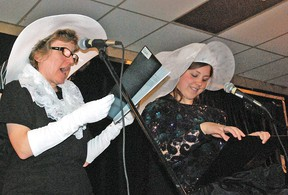 The annual Speaking Out for the Disabled Actively (SODA) Players Dinner Theatre was held at the Vulcan Legion Hall on Friday, April 12 before a sold out audience. The play performed was specifically tailored around Vulcan's centennial. Marianne Ulrich, left, and Jade Menin perform a scene in period costumes.