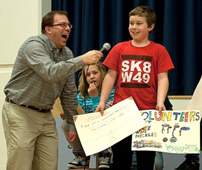 TAYLOR WEAVER HIGH RIVER TIMES Tim Radmanovich of Mr. Baldwin's grade four/five class at Spitzee Elementary School was one of many students to express their gratitude towards the many volunteers the school has to help make special events possible. The class used idioms to express how they felt and Radmanovich got a laugh out of Spitzee principal Kevin Newman and everyone in attendance that day.