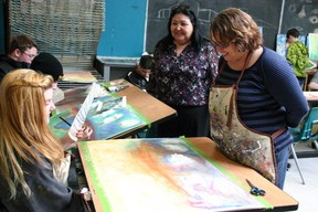 Edmonton-based artist Heather Shillinglaw, right, takes time Monday with a number of Composite High School students, including Grade 9 student Cierra Lowery, 15, as a part of an Alberta Foundation for the Arts grant. AMANDA RICHARDSON/TODAY STAFF