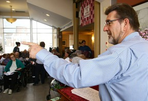 Auctioneer Tom Hamulecki is among the volunteers who made the 6th Annual Woodingford Lodge Spring Auction a success. Jeff Tribe/Tillsonburg News