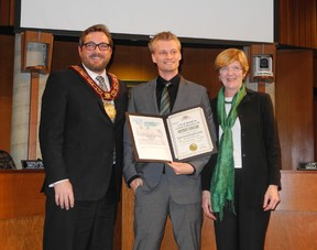 HUGO RODRIGUES, The Expositor   Reuben DeBoer accepts his 2013 Brantford Environmental Recognition Award for youth leadership from Mayor Chris Friel and Ward 5 Coun. Marguerite Ceschi-Smith.