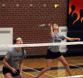 East Northumberland Blue Dragons' Leah Mitchell returns a shot as teammate Ally Wychopen waits for a return during the COSSA junior badminton championships last Thursday at ENSS in Brighton.