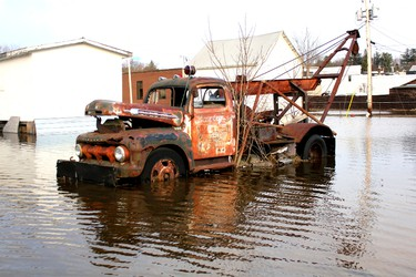 This truck parked behind a residence on Hastings street in Bancroft, Ontario is surrounded by the expanding overflow of the York River on Saturday, April 20, 2013. NATE SMELLE/ QMI AGENCY