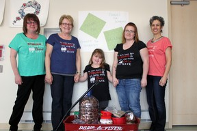 Family Health Team manager Tammy Tallon, RN certified diabetes educator Susan Clarke, Haileigh Bond, Kayli Bond and program assistant Marcella Yusko  with Haileigh's wagon filled with pennies. Photo by Dawn Lalonde/Mid-North Monitor/QMI Agency