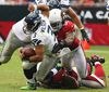 Seattle Seahawks quarterback Russell Wilson gets wrapped up by the Arizona Cardinals' Quentin Groves during the second half of their NFL football game in Phoenix, Arizona September 9, 2012. (REUTERS)