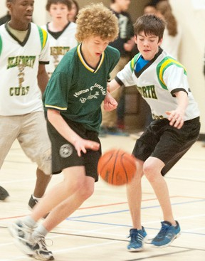 Kristopher Sepers, of Huron Centennial Public School dribbles past players from Seaforth Public, including Orlando Campbell, Adam Henry and Jared Smith.