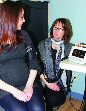 Rebecca Fortune has her blood pressure checked by Sue McCoubrey from Family Community Support Better Beginnings during a Pregnancy Circle group meeting held at the Kingston Community Health Centre.        ADRIENNE BABCOCK - KINGSTON THIS WEEK