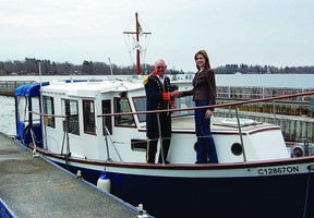 Chuckles Discovery Tours' Captain Lance and Thousand Islands Playhouse marketing manager Debbie Bennett celebrate the arrival of Chuckles the boat to their dock in Gananoque. The Playhouse will launch a new cruise and theatre initiative this season with a ceremony on May 1.    SUBMITTED PHOTO