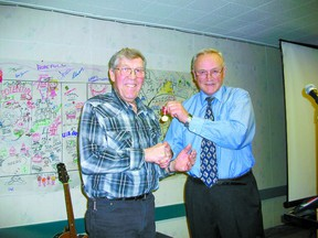 Ralph Eichhorn, left, a dedicated community volunteer, is presented the Queen Elizabeth Diamond Jubilee Medal by Coun. Dwight Davidson of Lac Ste. Anne County.