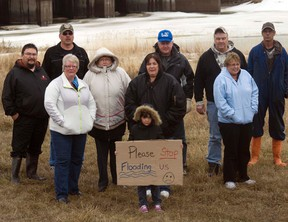 Protesters pictured in front of the Portage Diversion, Monday afternoon, where they were protesting the lack of compensation they received from the provincial government for the flood of 2011. By 11 p.m. Monday night they had moved the farm equipment they had placed in the diversion and the gates of the diversion were allowed to open. (ROBIN DUDGEON/THE GRAPHIC/QMI AGENCY)