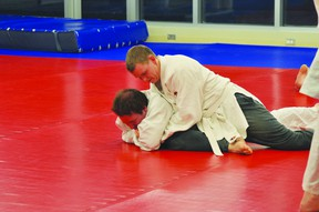 Portage la Prairie judokas Pinto Town, top, and Chysom Scott at Judo Club practice. (Kevin Hirschfield/THE GRAPHIC/QMI AGENCY)