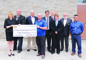 Ottawa Valley Rotary Clubs from Petawawa, Eganville, Renfrew and Arnprior collectively donated $14,000 to help kick start the Renfrew County Crisis Support Clinic for Youth and Families, which will help provide intervention support for youth and their families during times of personal crisis. In the photo, Monique Yashinskie, far left, administrator of the Robbie Dean Family Counselling Centre, and Tom Sidney, crisis centre supervisor, accept the cheque symbolizing the donation from Rotary Club representatives Bob French, Ray Serre, John Wilson, Dave Clarke, Kathy Loftus, Norm Edwards and Joe Fontes.