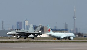 A CF-18 with the Royal Canadian Air Force lands at Pearson International Airport in Toronto.