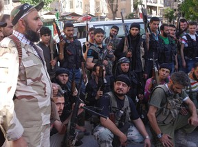 Free Syrian Army fighters plan an offensive in Aleppo. Although they have not committed atrocities on the scale of the government of Bashar al-Assad, a United Nations report still argues the rebel groups are guilty of their own share of war crimes in the conflict.