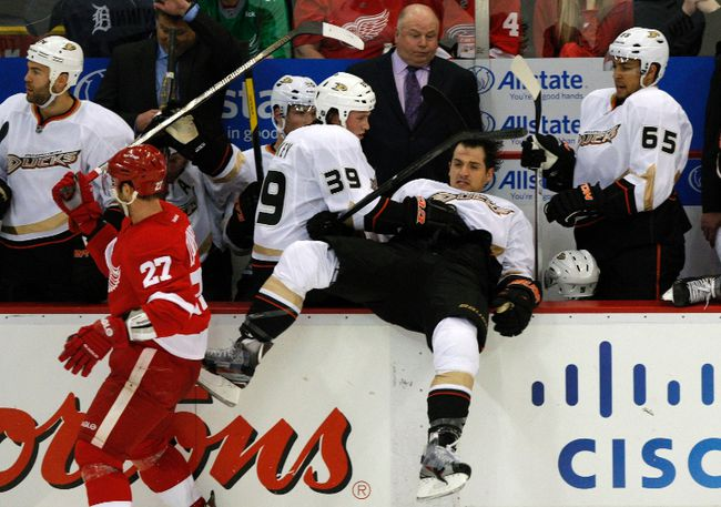 Anaheim Ducks defenceman Luca Sbisa is checked into the bench by Detroit Red Wings defenceman Kyle Quincey during Game 3 of their NHL playoff game in Detroit, May 4, 2013. (REUTERS/Rebecca Cook)