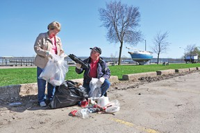 RYAN PAULSEN ryan.paulsen@sunmedia.ca  Marian Patterson and Pembroke Mayor Ed Jacyno take part in clean-up efforts along the city's waterfront on Saturday morning, organized by the local Communities in Bloom committee. For more community photos please visit our website photo gallery at www.thedailyobserver.ca.