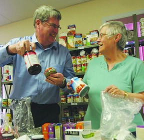 David Townsend, executive director with Southern Frontenac Community Services Corporation and volunteer Diane Dobing sort food at the SFCSC Food Bank in Sydenham. The organization is participating in the Give It Up for Hunger campaign to mark Hunger Awareness Week, which takes place May 6-10. Hunger Awareness Week is a week-long initiative that challenges Canadians to learn more about the issue of hunger, the important work of food banks and to take action.      ROB MOOY - KINGSTON THIS WEEK / FRONTENAC THIS WEEK