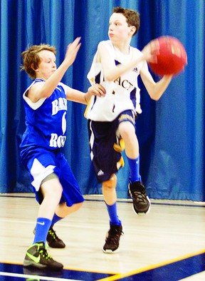 Kingston Impact's U13 bantam boys basketball player Ethan Cahill looks for an open teammate before running over the baseline in a game against the Barrie Royals during the Ontario Basketball Provincial Championships. The championships were held at various recreation centres in Kingston from April 19-21. Kingston finished fourth overall in Division 5.    ERIC HEALEY - KINGSTON THIS WEEK