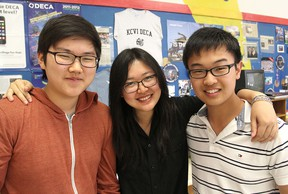 Brandon Lee, left, Maggie Shi and Kevin Zhang are members of a team from KCVI that won a prestigious international  business competition for high school students. Michael Lea The Whig-Standard