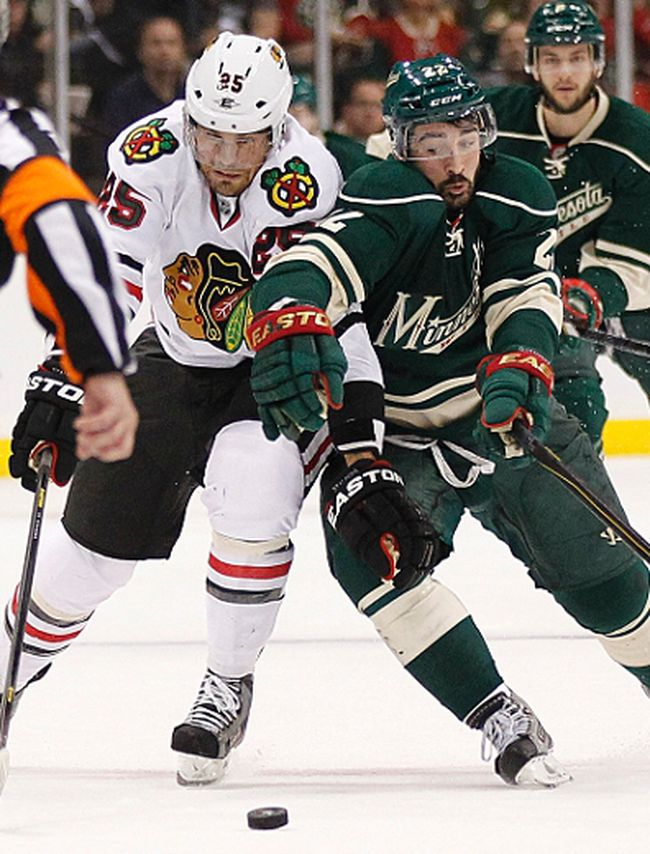 Blackhawks forward Viktor Stalberg challenges Wild forward Cal Clutterbuck during Game 4 of their NHL Western Conference quarterfinal at the Xcel Energy Center in St. Paul, Minn., May 7, 2013. (ANDY KING/Reuters)