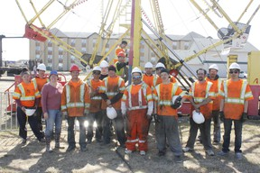 Crew tasked with setting up the carnival take a break to pose for a photo.  The carnival opens this Friday, May 10.