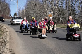 Lions club members were out in the community this week, leading a wheelchair procession to the campground on Friday, May 3, and reading to students at Holy Spirit Catholic and Robina Baker Elementary Schools on Tuesday.