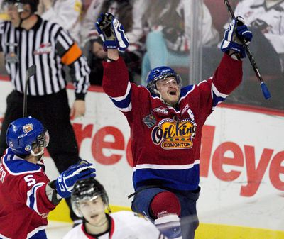 PORTLAND, OREGON - May 10, 2013 -  Edmonton's #18 Michael St. Croix celebrates after scoring the winning goal in overtime before being mobbed by team mates in the corner of the ice.  The Edmonton Oil Kings beat the Portland Winterhawks 3-2 in overtime in game 5 of the WHL playoffs at the Rose Garden.    Doug Beghtel/ The Oregonian