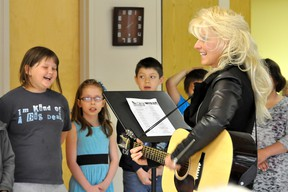 """Students from Val Smith's Grade 3 class at North Memorial School brought some vocal sunshine to the residents of Douglas Campbell Lodge Friday afternoon as a pre-Mother's Day treat. Their repertoire included """"On Top of Old Smoky"""", """"You are my Sunshine"""" and their theme song for the school year, """"Rockin' and Rollin' in Grade 3"""". (CLARISE KLASSEN/PORTAGE DAILY GRAPHIC/QMI AGENCY)"""