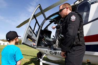 Pilot Cst. Tyler Tebbutt answers questions about the police helicopter during Get Ready in the Park at Hawrelak Park in Edmonton, Alta. on Saturday, May. 11, 2013. The event is part of Emergency Preparedness Week in Edmonton. Amber Bracken/Edmonton Sun/QMI Agency