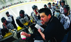 Coach Mike Dube talks to his team during a time out in a pre-season game between the Kingston Kings and Gloucester Griffins at Centre 70 arena.The Kings will open their regular schedule Thursday, May 9, at home against Gloucester.      ERIC HEALEY - KINGSTON THIS WEEK