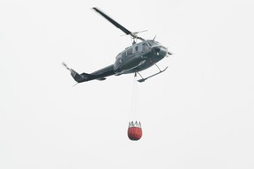 An ESRD helicopter drops water on a wildfire. DHT file photo