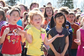 Kaidyn Peach, Jaelynn Thompson and Carly Lai sing 'The Kindness Song' during Pat Hardy Primary School's Music Monday festivities. Barry Kerton | Whitecourt Star