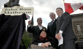Retired Judge John Matheson, seated, is surrounded, from left, by Brockville Mayor David Henderson, Leeds-Grenville Warden Ron Holman and Leeds-Grenville MP Gord Brown, who unveiled a street name in recognition of Matheson's key role in designing the Maple Leaf flag in 1965. (NICK GARDINER The Recorder and Times)