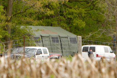 The burned body of Tim Bosma, the Ancaster man who went missing May 6, has been found on a farm 12 km west of Cambridge owned by the family of accused abductor Dellen Millard. Waterloo and Hamilton Police vehicles can be seen at the back of the property May 13, 2013, and a tent has been set up to protect the crime scene. (CHRIS DOUCETTE/Toronto Sun)