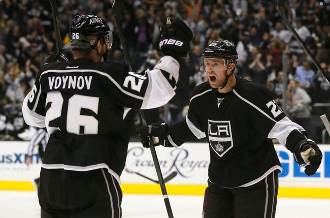 Los Angeles Kings forward Trevor Lewis (right) celebrates with Slava Voynov during their first-round playoff series against the St. Louis Blues. (REUTERS/Lucy Nicholson)