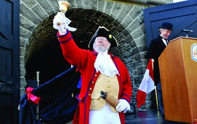 Town crier Lawrence Levere proclaims the induction of the Brockville railway tunnel into the Canadian Railway Hall of Fame on Tuesday evening. In the background is railway tunnel committee member Brian Porter. (RONALD ZAJAC/The Recorder and Times)