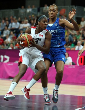 Canada's Tamara Tatham runs into Sandrine Gruda of France during women's basketball competition at the 2012 Olympic Summer Games in London. File Photo/QMI Agency