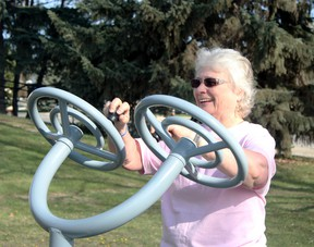 Karen Singer added using the outdoor exercise equipment to her exercise routine as part of the Community Wellness Challenge