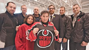 Gabe Costantini (front left) and Marcos Neziol of the Brantford 99ers minor peewee AA team check out the new jersey of the Brantford 99ers Junior B hockey team. Also in the photo are Mayor Chris Friel and team owners Mike Spadafora (left), Ken Lindsay, Scott Rex, Paul Polillo and Darren Dedobbelaer.  (Brian Thompson, The Expositor)