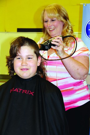 SEAN CHASE Eric Zadow doesn't mind losing his locks for a good cause. After raising $2,205, the Our Lady of Lourdes student sat down for the hair cut delivered by hairdresser Colleen Lanthier.