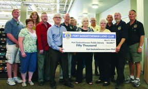 The Fort Saskatchewn chapter of the Lions Club opened up its purse strings to the tune of $50,000 last week as they donated to the new public library's children's section, and early literacy and learning zone.  Photo by Aaron Taylor/Fort Saskatchewan Record/QMI Agency