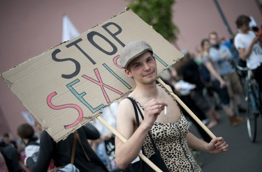 A demonstrator protests in front of the so called Barbie Dreamhouse - the first life-sized giant mansion dedicated to the doll in Europe, after its opening near the Alexanderplatz in Berlin on May 16, 2013. Protesters are mobilizing against the 2,500-square-metre Barbie mansion they call a sexist icon.    (AFP PHOTO/BARBARA SAX)