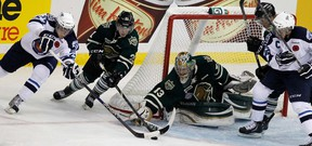 London Knights Anthony Stolarz makes the save on Michael Ferland of the Saskatoon Blades during the 2013 MasterCard Memorial Cup in Saskatoon. (Al Charest, QMI Agency)